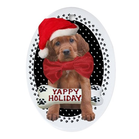 Irish Setter Christmas puppy in paw Oval Ornament