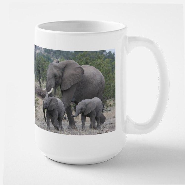mother elephant and infants Mugs