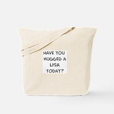Hugged a Lisa Tote Bag