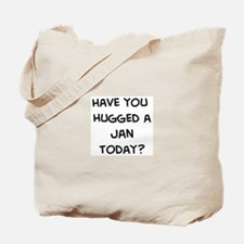 Hugged a Jan Tote Bag