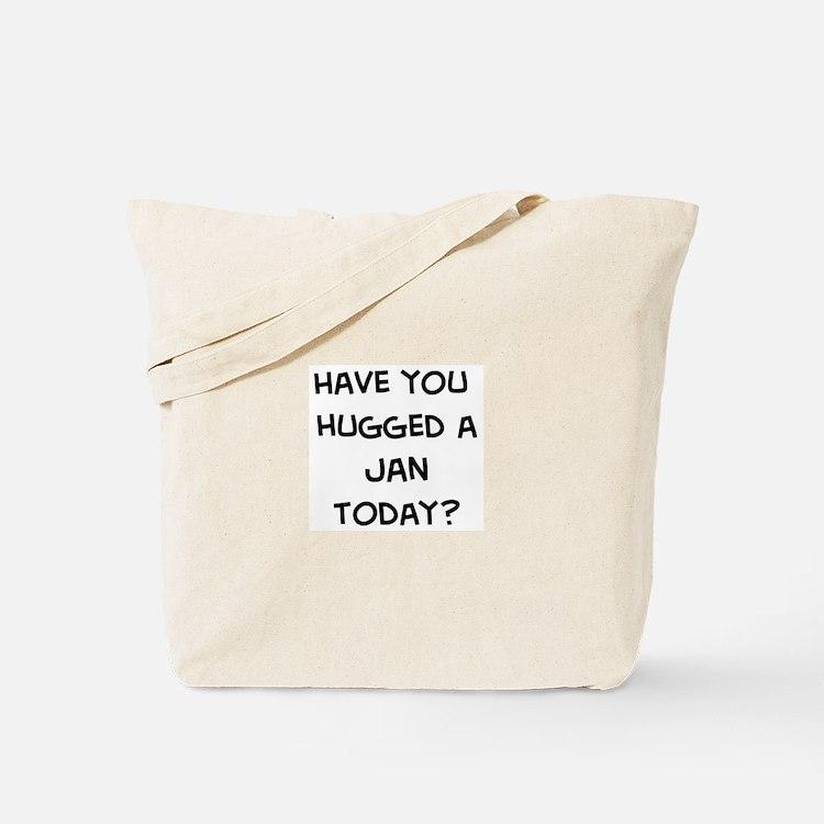 Hugged a Jan Tote Bag