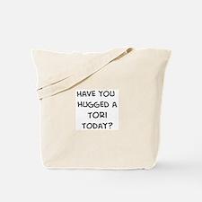 Hugged a Tori Tote Bag