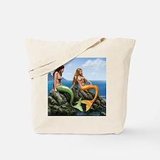 pensive mermaids on rocks covered Tote Bag