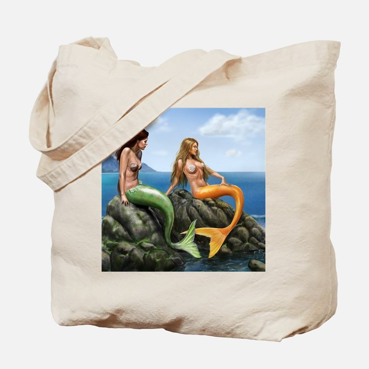 pensive mermaids on rocks covered Tote Bag