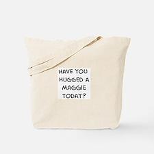 Hugged a Maggie Tote Bag