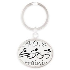 140.6 In Training Black on WHite Oval Keychain