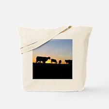 Cows at sundown Tote Bag