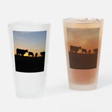 Cows at sundown Drinking Glass
