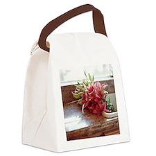 Stargazer lilies in kitchen sink Canvas Lunch Bag