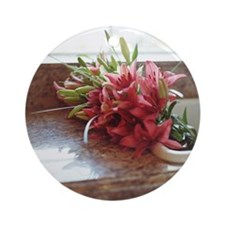 Stargazer lilies in kitchen sink Round Ornament