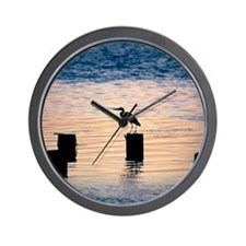 Silhouette of an egret perching on a wo Wall Clock
