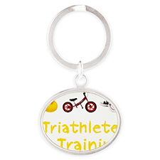 Triathlete_In_Ttraining_wht Oval Keychain