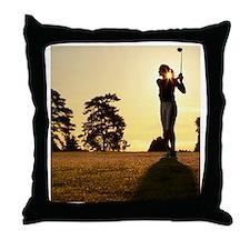 Female golfer swinging club on golf c Throw Pillow