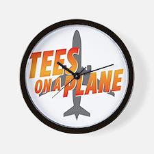 tees on a plane Wall Clock