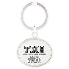 TEXAS - AIRPORT CODES -TE09 - MINARD Oval Keychain
