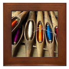 Various threads on weaving loom Framed Tile