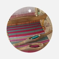 Various threads on weaving loom Round Ornament