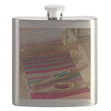 Various threads on weaving loom Flask