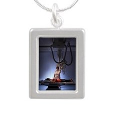 Taking an X-ray Silver Portrait Necklace