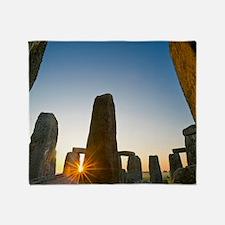 Stonehenge at sunrise Throw Blanket