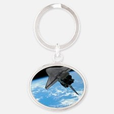 Space shuttle entering Earth orbit Oval Keychain