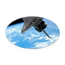Space shuttle entering Earth orbit Oval Car Magnet