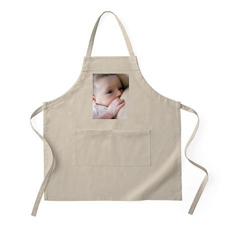 Six week old baby girl breastfeeding Apron