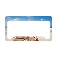 Beach chairs in the sand License Plate Holder