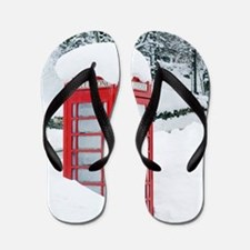 Red telephone box in heavy snow Flip Flops