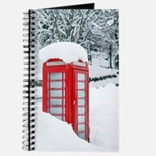 Red telephone box in heavy snow Journal