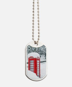 Red telephone box in heavy snow Dog Tags