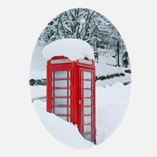 Red telephone box in heavy snow Oval Ornament