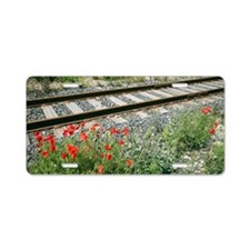 Poppies beside a rail track Aluminum License Plate