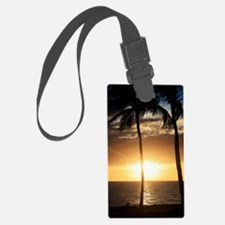 Palm trees on a beach at sunset Luggage Tag