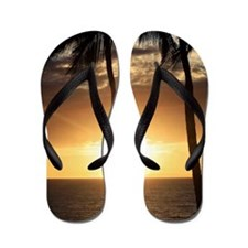 Palm trees on a beach at sunset Flip Flops