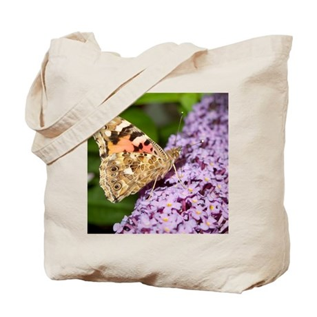 Painted lady butterfly feeding Tote Bag
