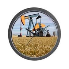 Oil pump in a wheat field Wall Clock