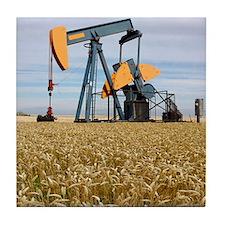 Oil pump in a wheat field Tile Coaster