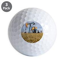 Oil pump in a wheat field Golf Ball