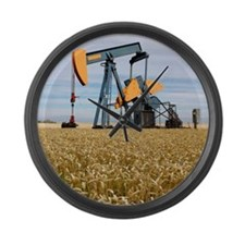 Oil pump in a wheat field Large Wall Clock