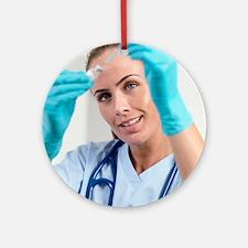 Nurse preparing an injection Round Ornament