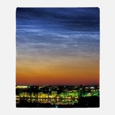 Noctilucent cloud over a city Throw Blanket