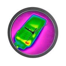 Mobile phone on charge, thermogram Wall Clock