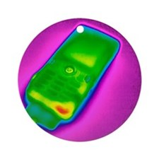Mobile phone on charge, thermogram Round Ornament
