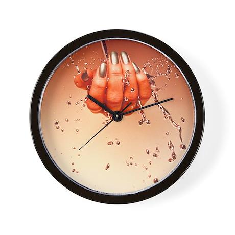 Mercury flowing through fingertips Wall Clock