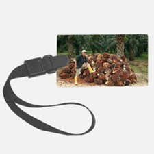 Mature man posing by oil palm fr Luggage Tag