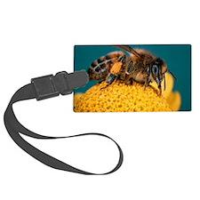Honey bee on flower Luggage Tag