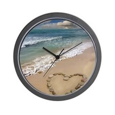 Heart-shape on a beach Wall Clock