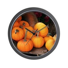 Harvested pumpkins Wall Clock