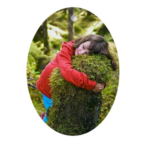 Girl hugging a tree stump Oval Ornament